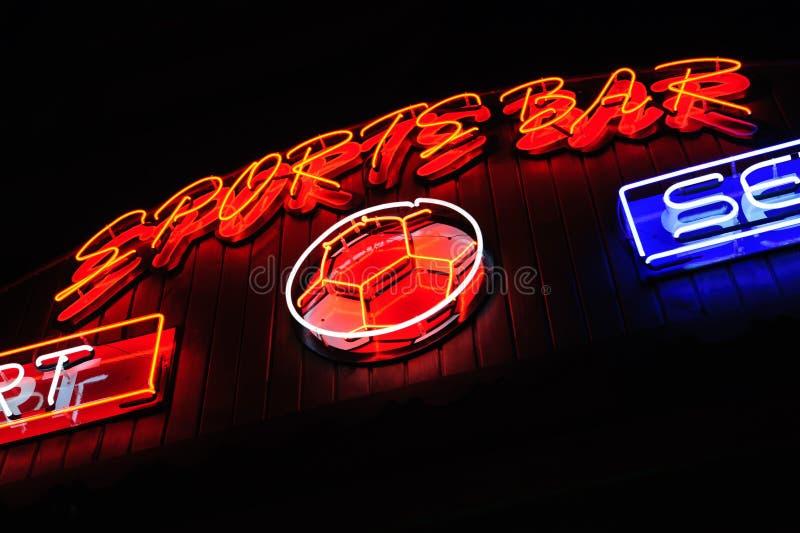 Neon signboard. Neon shining signboard at night royalty free stock image