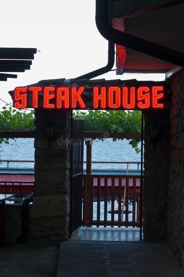 Neon signboard steak house. Bulgaria royalty free stock photos
