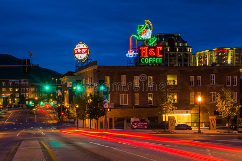 Neon signs and buildings along Williamson Road at night in downtown Roanoke, Virginia royalty free stock photography