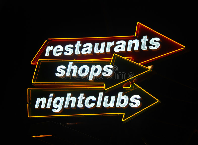 Neon signs at nightlife hotspot. Signs directing travelers to nightlife venues stock images