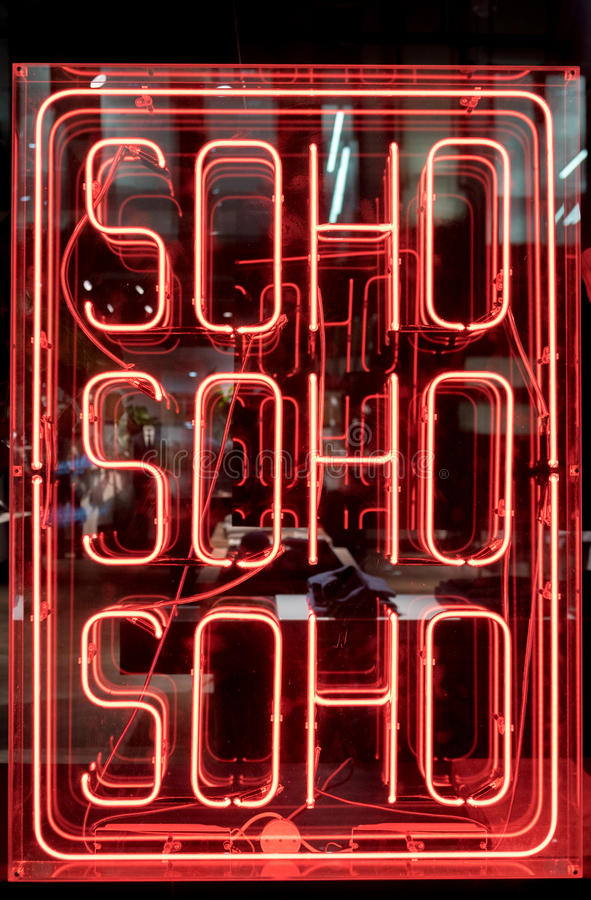 Neon Soho Sign. Red Neon Soho Sign Illuminated in London royalty free stock images