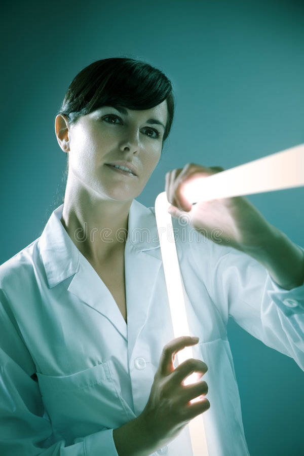 Neon stick. Italian woman holding neon stick in lab royalty free stock image