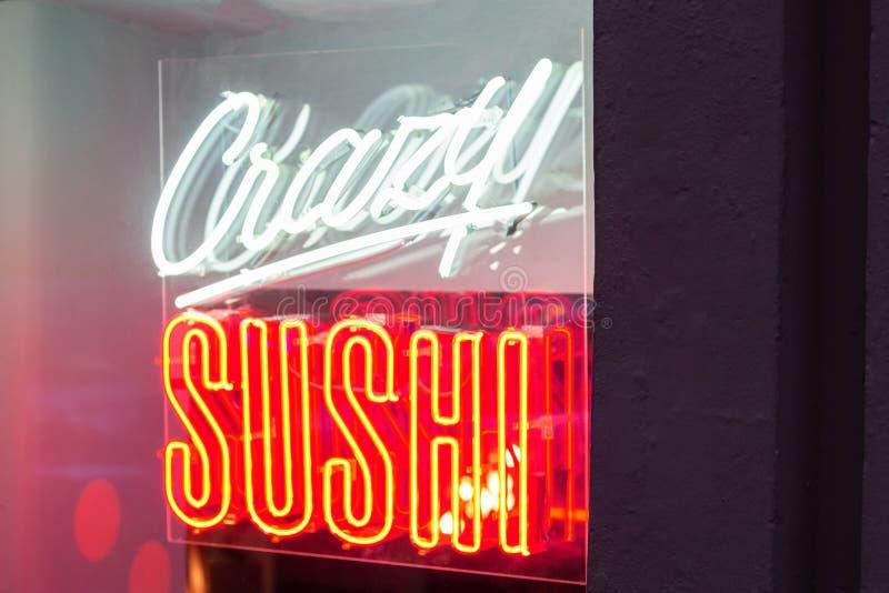 Neon sushi advertising sign. restaurant window light design bar. Neon sushi fish advertising sign. restaurant window light design bar stock photo