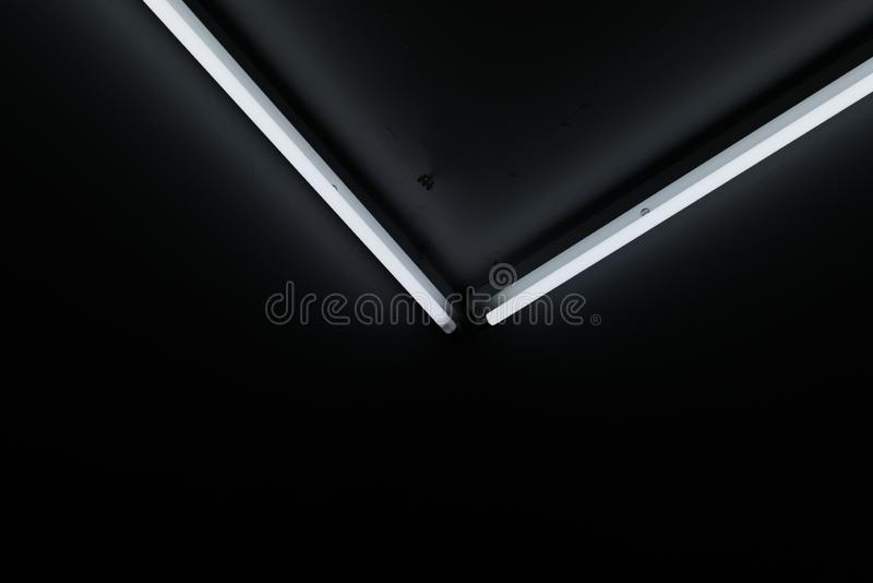Neon tubes in a V-shape royalty free stock images