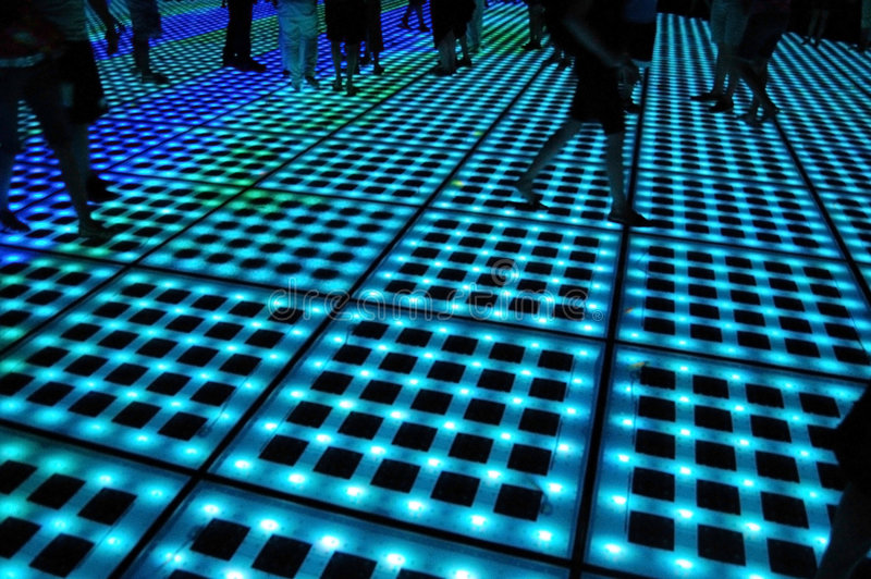 Neon walk. Nightshot of people walking on the new, unique atractions of Zadar (Croatia): the GREETING TO THE SUN (which consists of three hundred multi-layer royalty free stock photo
