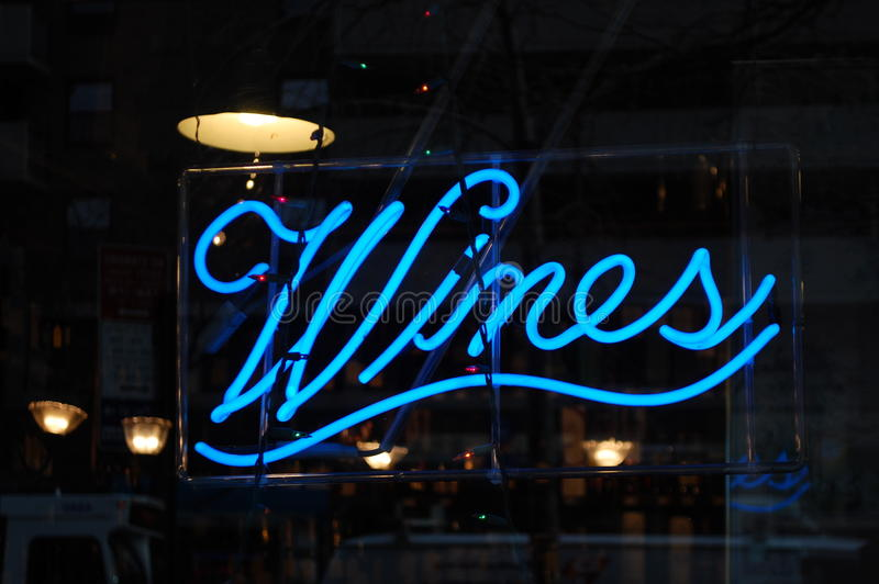 Neon Wines Sign. A neon sign in a shop window advertises wines for sale within royalty free stock photo