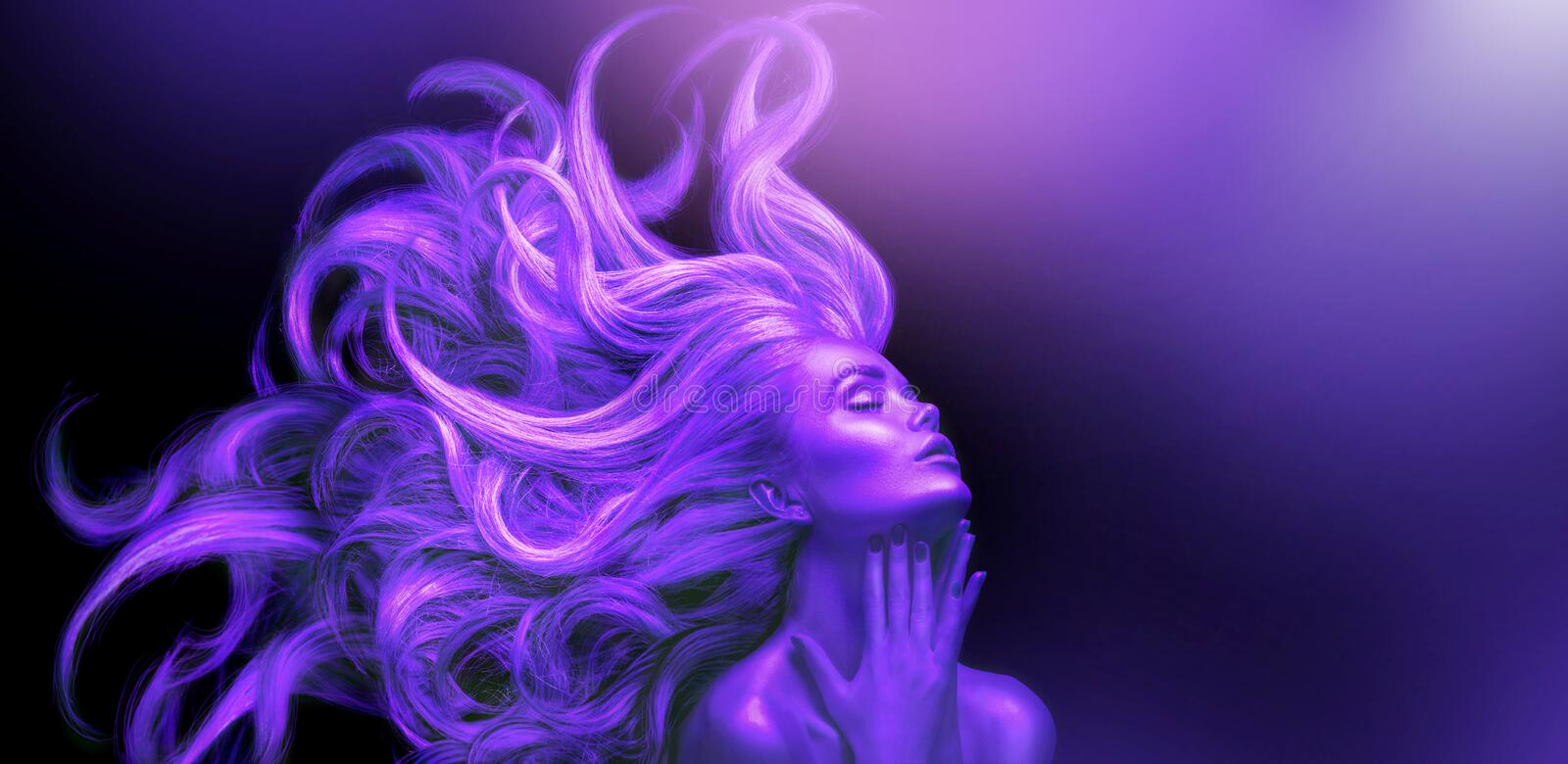 Neon Woman. Beauty fashion model girl with Long hair on black background in UV lights. Violet glowing skin and fluttering hair. Ultraviolet Dancing girl, art royalty free stock photography