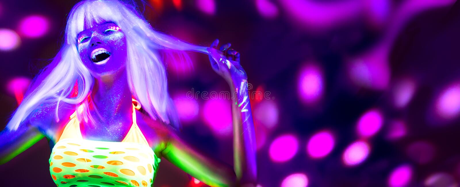 Neon Woman dancing. Fashion model woman in neon light, portrait of beautiful model with fluorescent makeup. Neon Woman dancing. Fashion model woman in neon light royalty free stock image