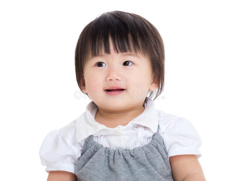 Neonata asiatica che guarda da parte fotografie stock libere da diritti
