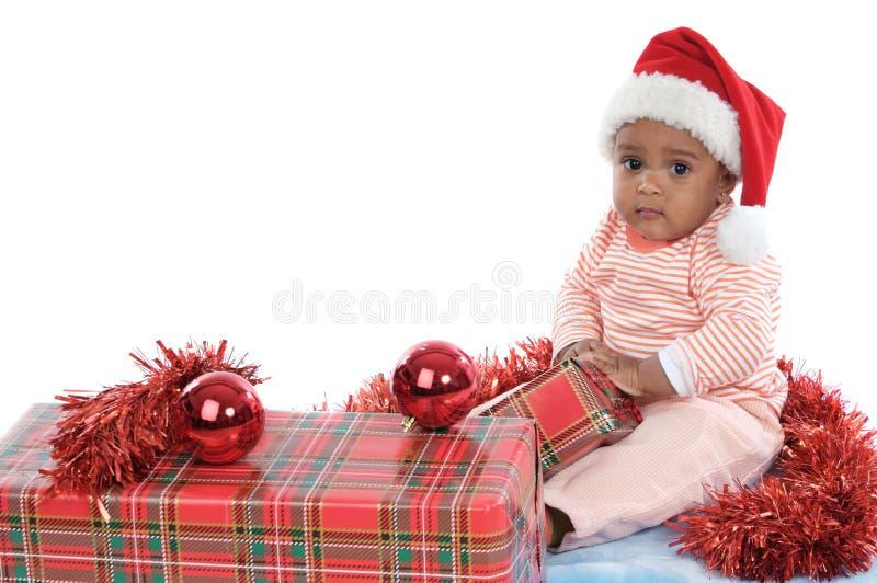Neonata con i regali di Natale fotografia stock