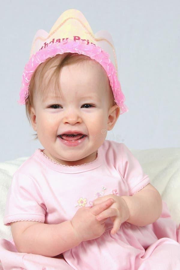 Neonata con il cappello di compleanno fotografia stock libera da diritti