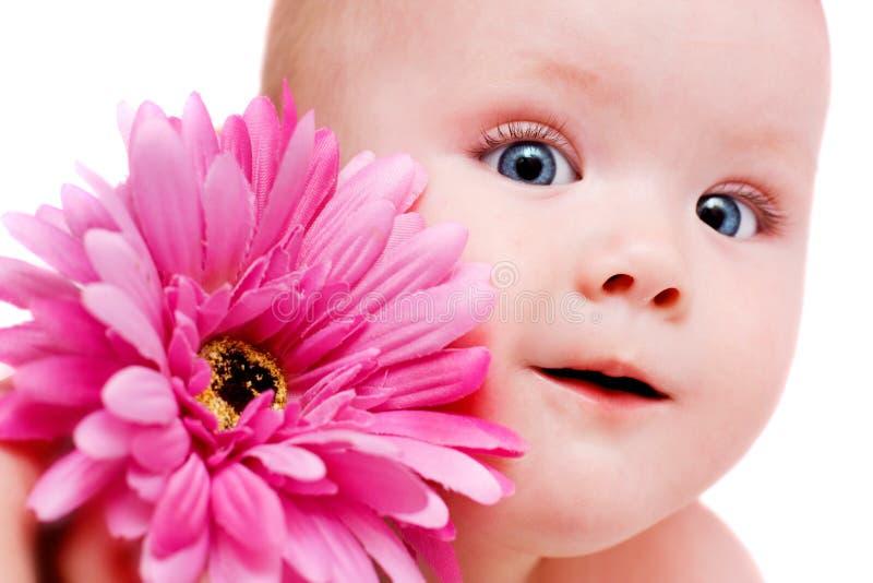 Neonata con il fiore immagini stock libere da diritti