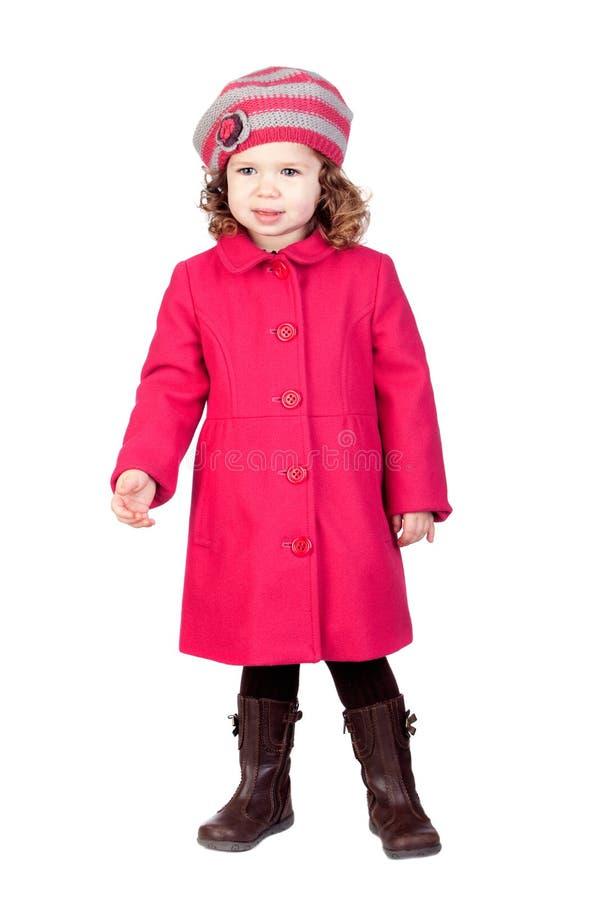 Neonata sorridente con il cappotto dentellare immagine stock