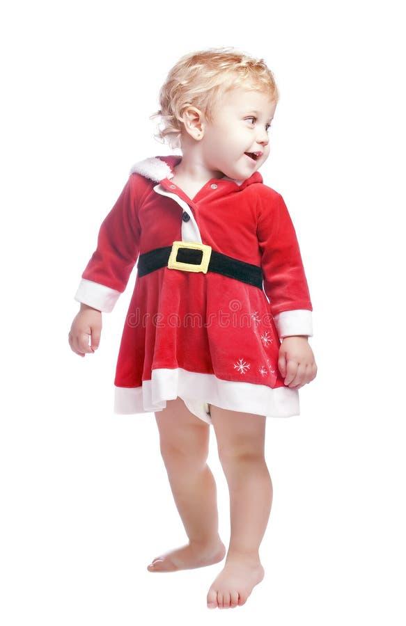 Neonata in un vestito operato da natale rosso immagini stock