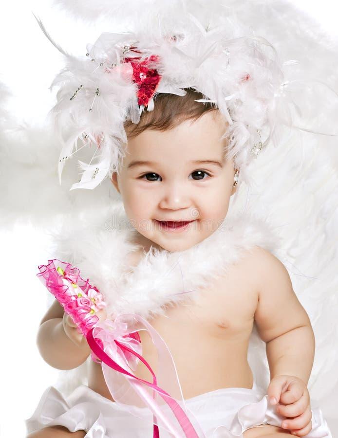Neonato asiatico in un vestito operato da angelo fotografia stock libera da diritti