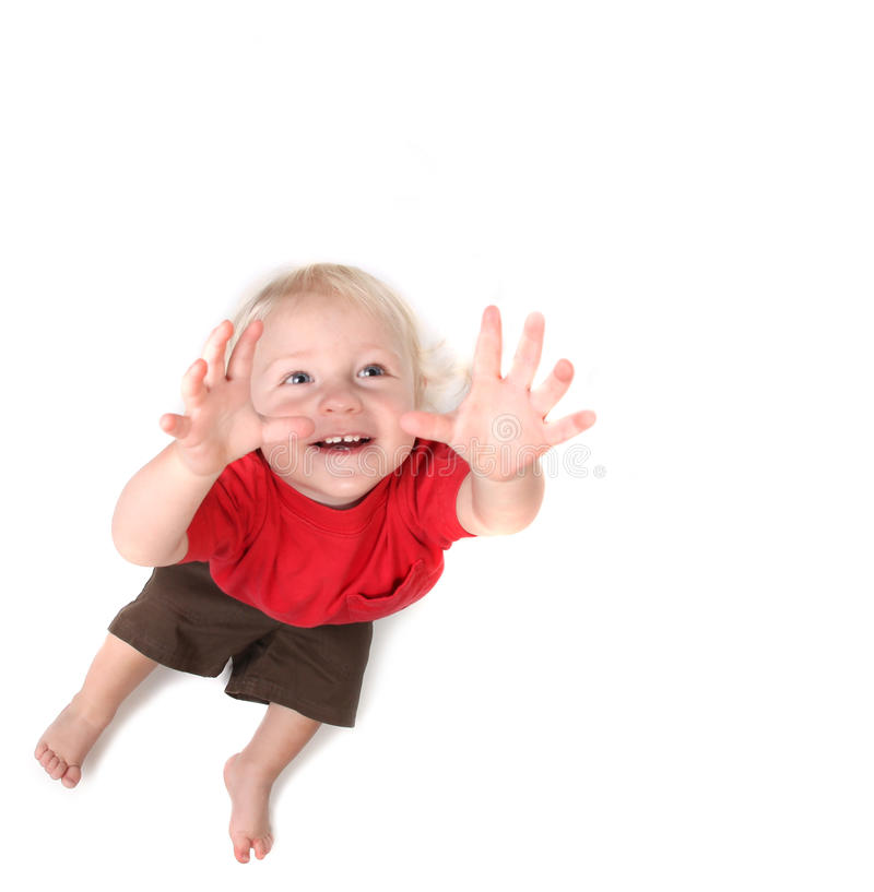 Neonato del bambino che raggiunge per il cielo fotografia stock