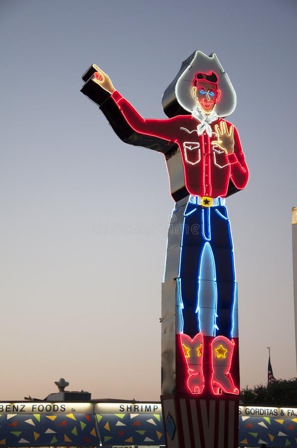 Neoncowboy Statue på Texas State Fair arkivbild