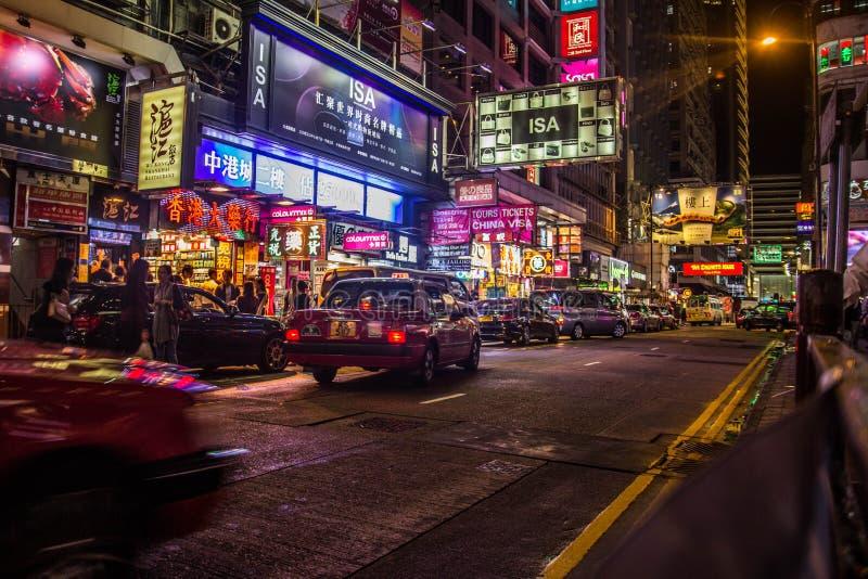 Neonowi światła na Tsim Sha Tsui ulicie obraz royalty free