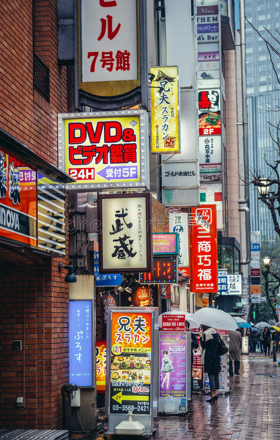 Neons in Tokyo. Tokyo, Japan - February 26, 2015: View on the banners and neon signs on one of the streets in Akasaka district stock photos