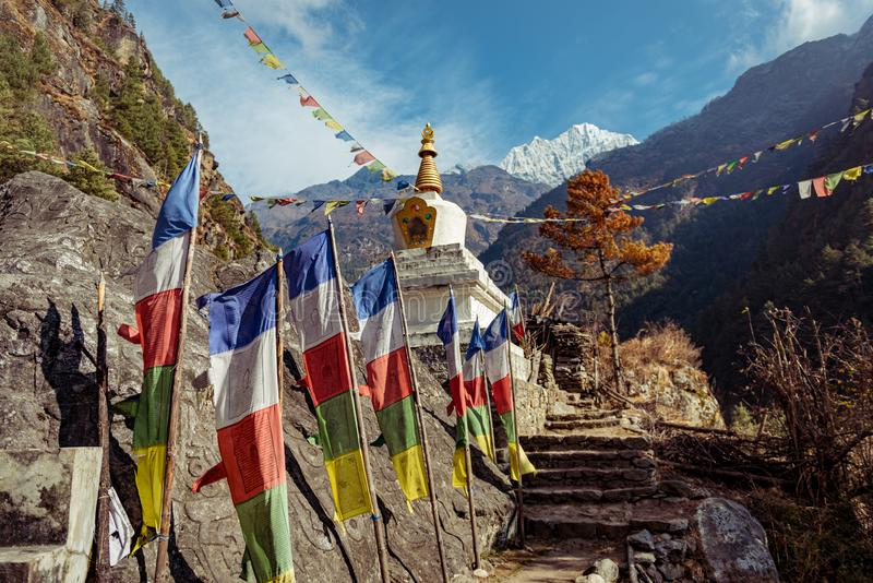 Enlightenment Stupa. Nepal is full of beautiful landscapes covered in these amazing pray flags and Stupas. This one in particular is the Enlightenment Stupa, it royalty free stock photography
