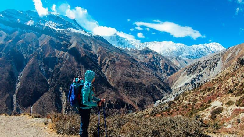 Nepal - Girl trekking in Himalayas stock photography