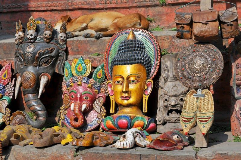 Nepal, Kathmandu, Ganesha Elephant God Head Mask and the others souvenirs on street market royalty free stock photography