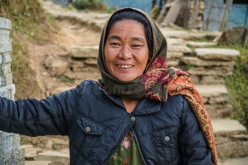 NEPAL - NOVEMBER 11, 2018: Portrait of Smiling Authentic Nepalese Woman in Rural Area.  stock photo
