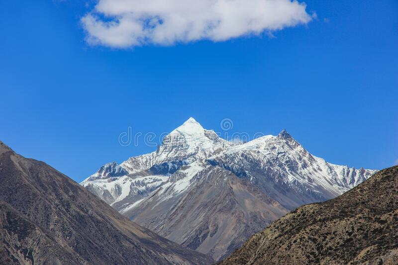 Nepal snowy mountains against the blue sky with clouds.  royalty free stock photo