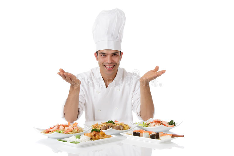 Nepalese chef diversity meals. Young attractive nepalese man chef showing diversity of oriental meals on plates. Studio shot, white background royalty free stock photography