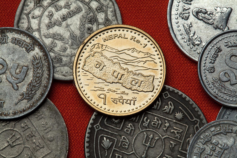 Nepalese coins. Map of Nepal and the Himalayas. Coins of Nepal. Map of Nepal and the Himalayas depicted in the Nepalese one rupee coin stock images
