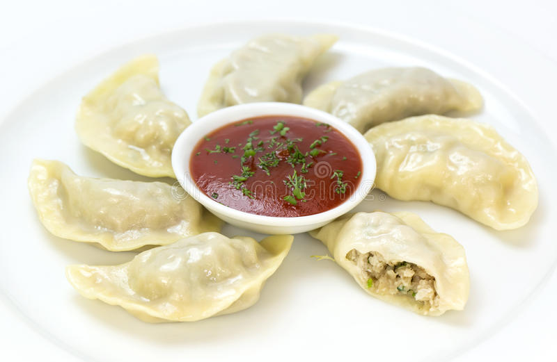 Nepalese food momo. On a white background in the restaurant stock photo