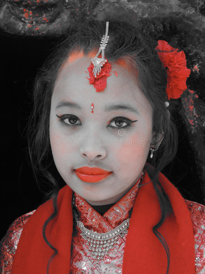Nepalese girl. Kathmandu, Nepal- January 25 2013: Portrait of a Nepalese young girl dressed for a celebration stock photos