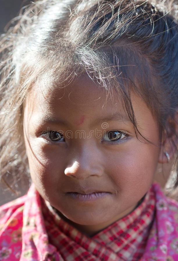 Nepalese girl playing at Durbar square in Bhaktapur, Nepal stock photo
