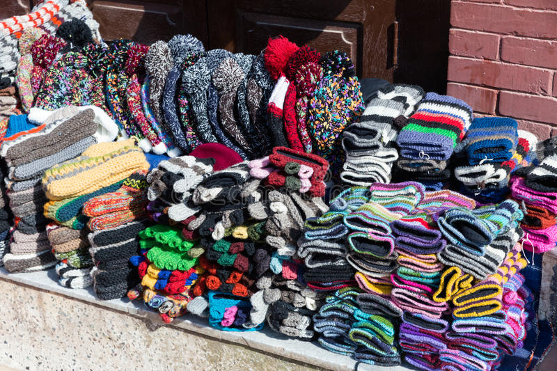 Nepalese handmade knitted hats and mittens stock photos