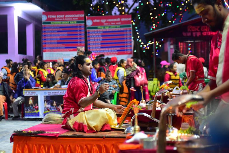 Nepalese Hindu priest performing Aarti ceremony at Pokhara royalty free stock photos