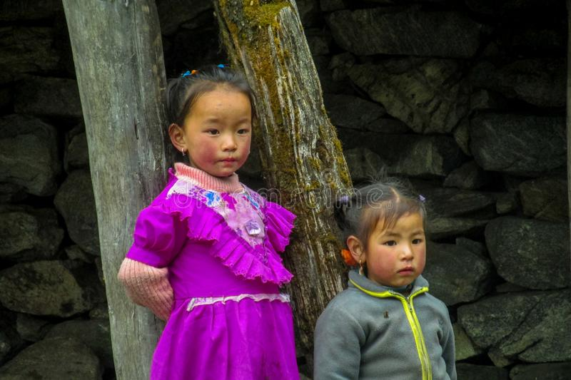 Nepalese little girls in the village on the street. Children, small kid portrait outside in Nepal stock photos