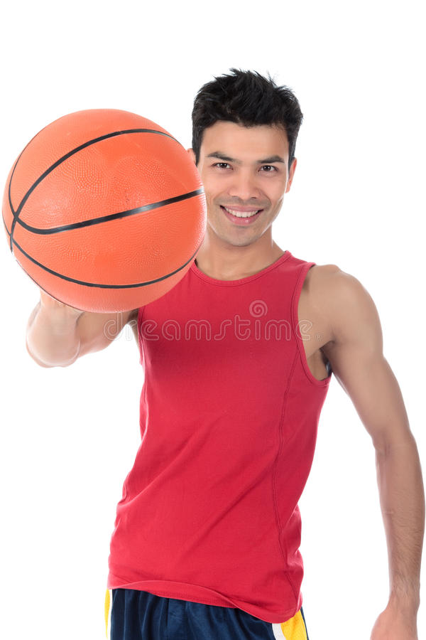 Nepalese man basketball player. Attractive Nepalese man basketball player smiling, ball in hand. Studio shot. White background royalty free stock image