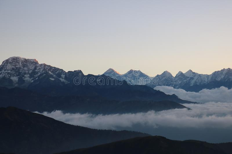 Nepalese Many Mountain Peak Area Natural Scene with background sky royalty free stock photos