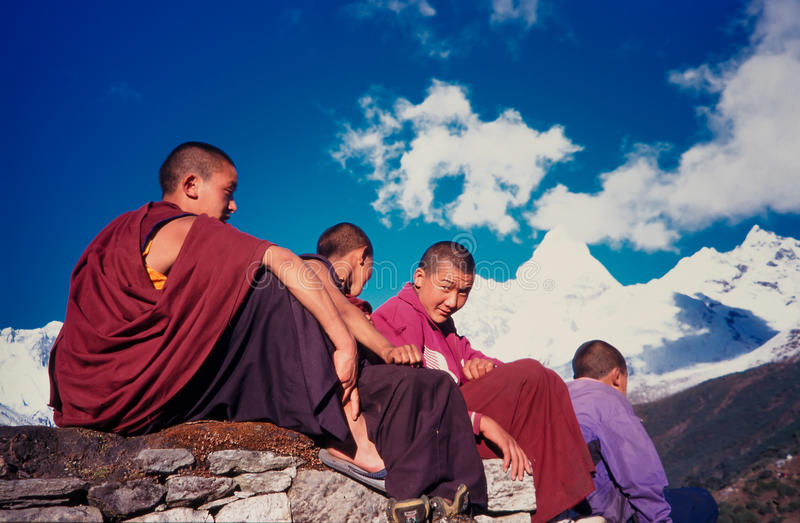 Nepalese monks. 21 March 1997: Nepalese monks below the summit of 'Amadablam in the village of Tengboche royalty free stock photography