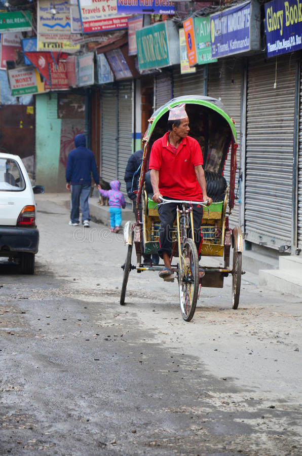 Nepalese people riding tricycle at street of thamel market royalty free stock photos