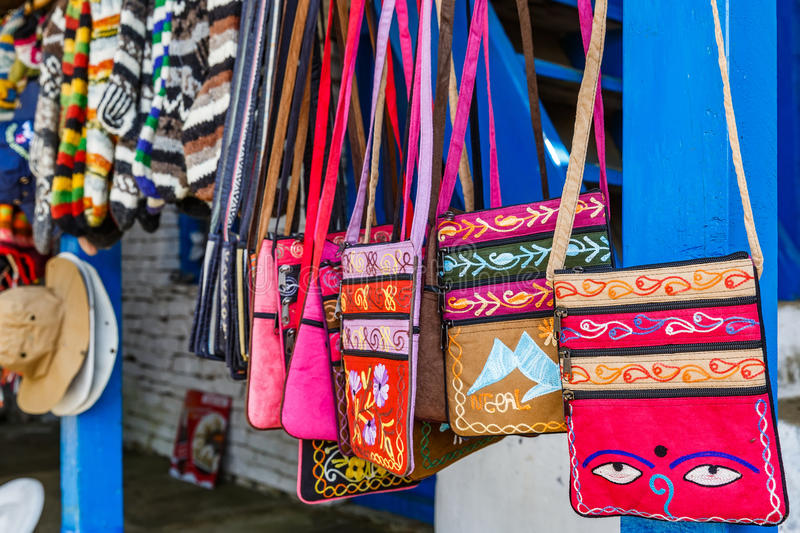 Nepalese souvenir shop. Photo of colorful small bags in nepalese souvenir shop stock image