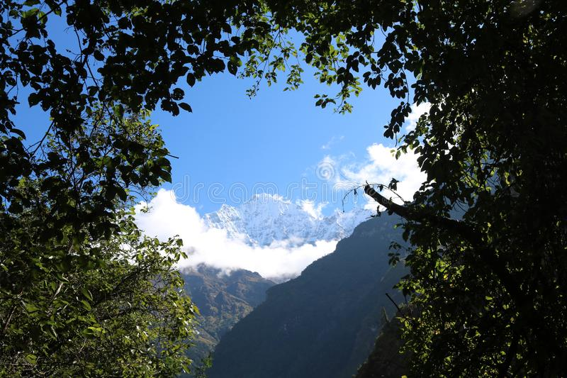 Nepalese Thamserku is mountain in the Himalayas of eastern Nepa. Nepalese Mountain Thamserku is lies on east of Namche Bazaar and lies just north of Kusum stock photo