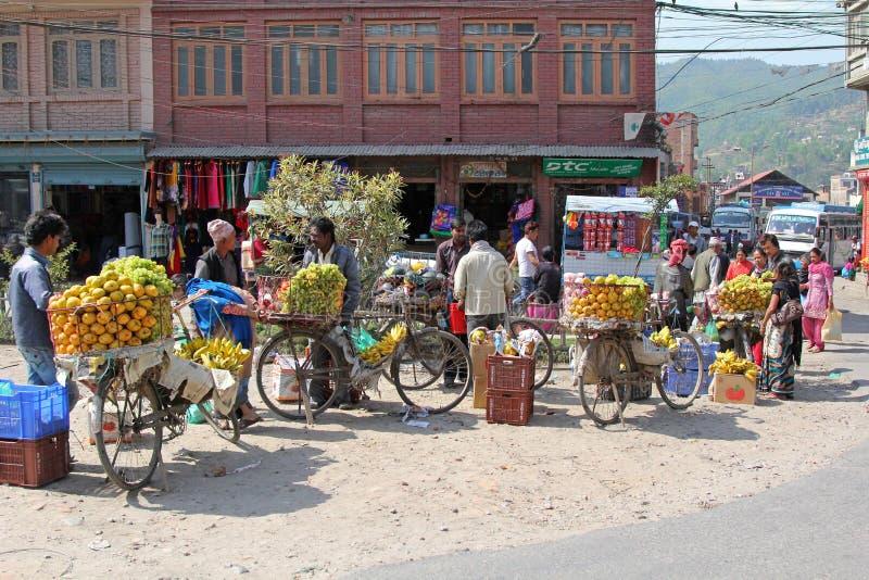 Nepalese venders selling fresh fruit on bicycle in Nepal. SANGA, NEPAL - APRIL 2014 : Nepalese venders selling fresh fruit on bicycle in Sanga, Nepal on 19 April royalty free stock image