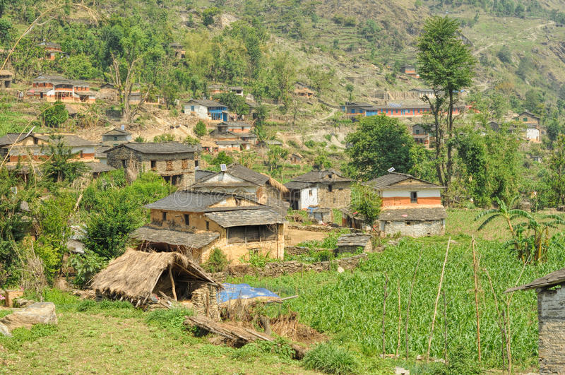 Nepalese village. Picturesque view of a Nepalese village lying in a valley stock photo