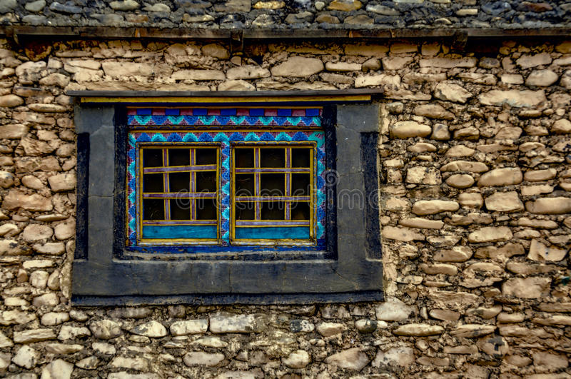 Nepalese window. Traditional decorated window on old stone nepalese house stock photos
