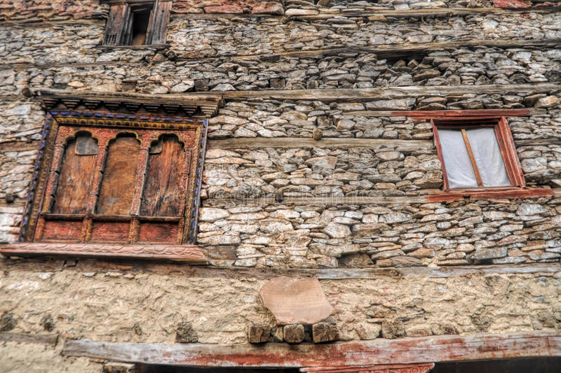 Nepalese window. Traditional decorated windows on old stone nepalese house royalty free stock photos