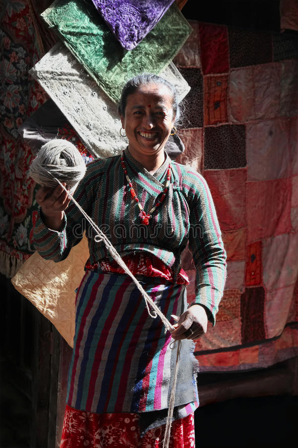 Nepalese woman. With ball of wool royalty free stock images