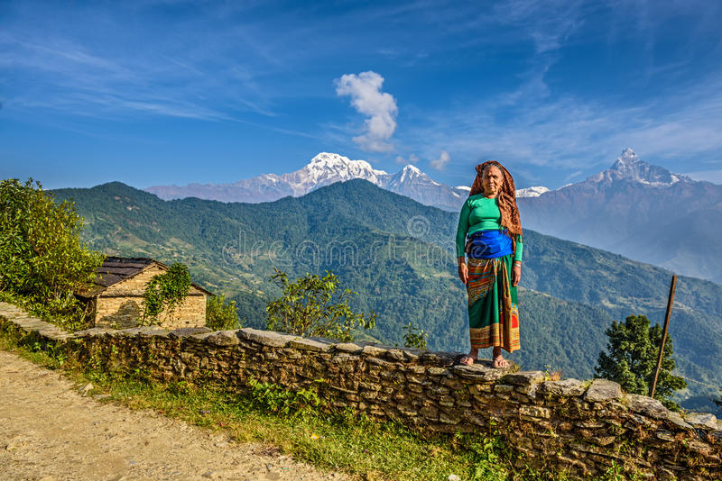 Nepalese woman in front of her home in the Himalayas mountains. DHAMPUS, NEPAL - OCTOBER 27, 2015 : Nepalese woman in front of her home in the Himalayas stock images