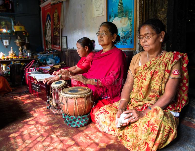 Nepalese women playing drums royalty free stock photos