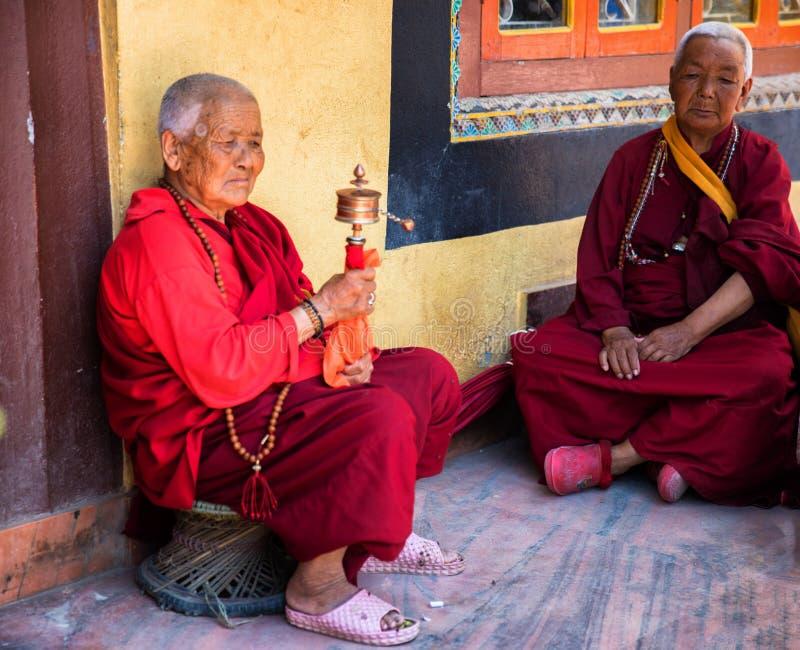 Nepalese women praying. At Boudhanath Stupa, Kathmandu, Nepal royalty free stock photos